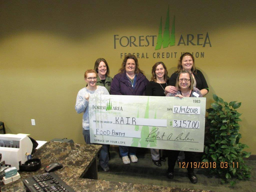 employees with donation check